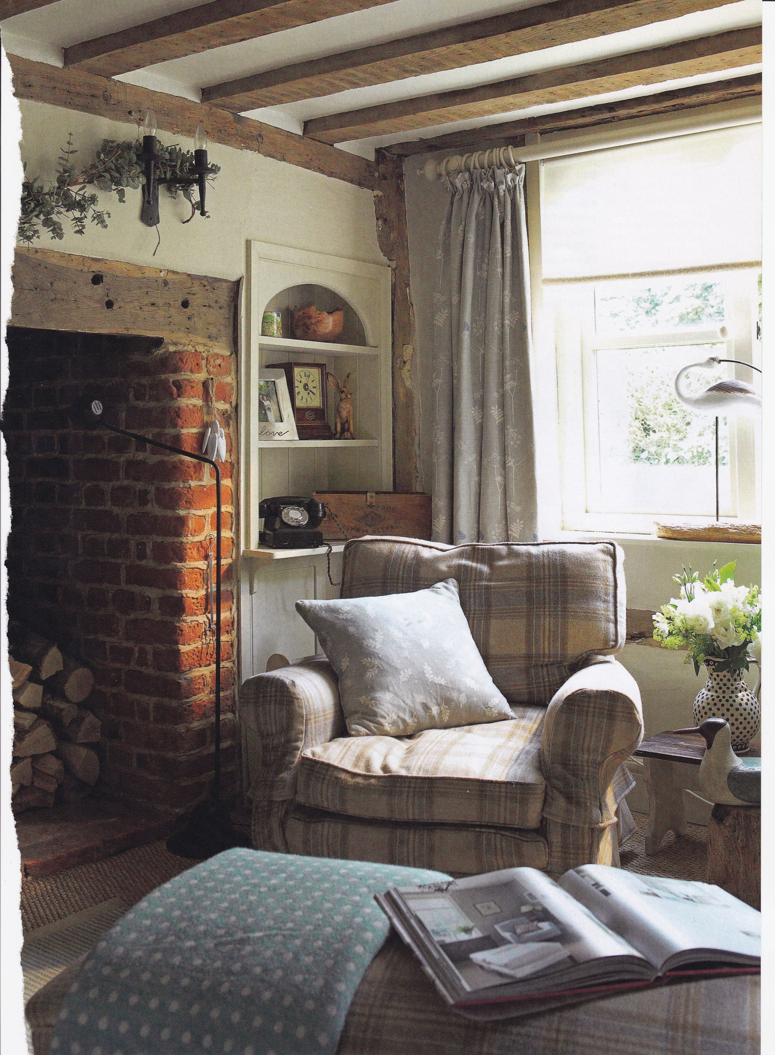 Cosy cottage living room Checked armchair and