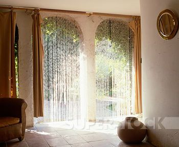 Cream Curtain At Arched Doorway With View Of Tiled Bathroom With Brown Steps To Raised Circular Bath Stock Photograph U28645896 Home Arch Doorway Master Bedroom Design