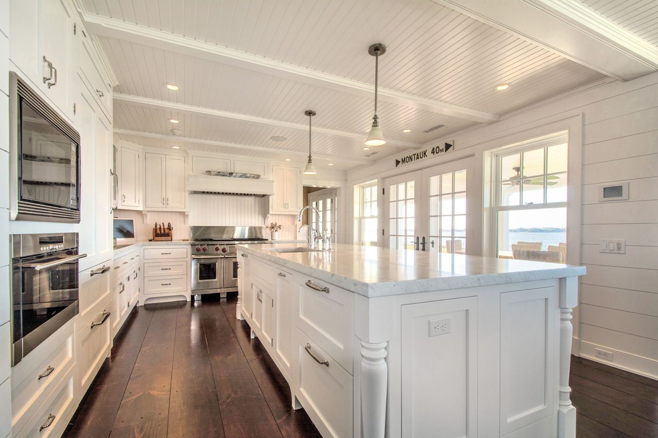 Hamptons Kitchen Design. Hamptons Real Estate  Beautiful kitchen design with Restoration Hardware Clemson Pendants over white island