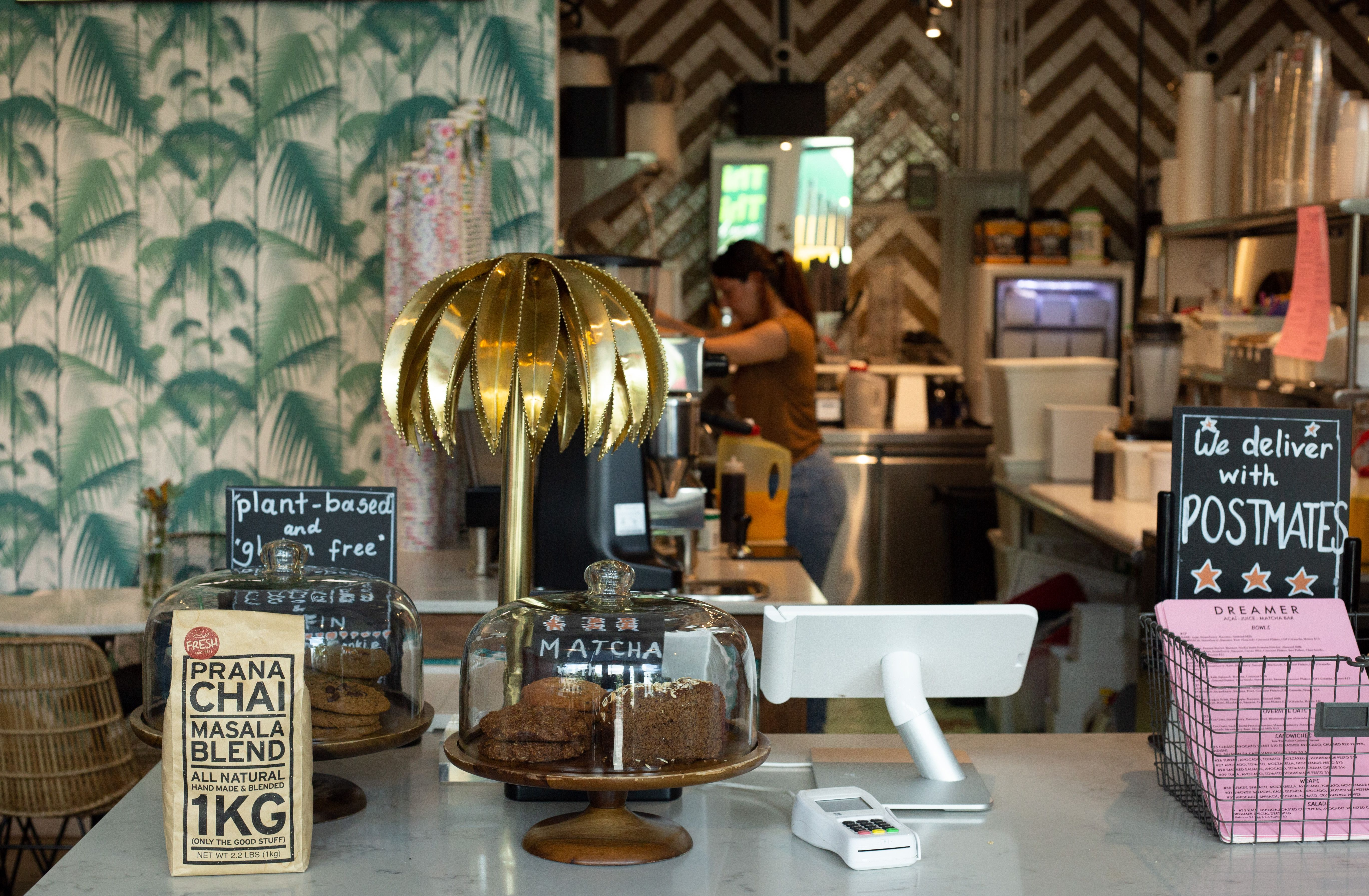 Dreamer Matcha And Acai In Miami Beach Be Sure To Check Out That Flamingo Wallpaper Too Wooden Garage The Dreamers Wood Garage Doors
