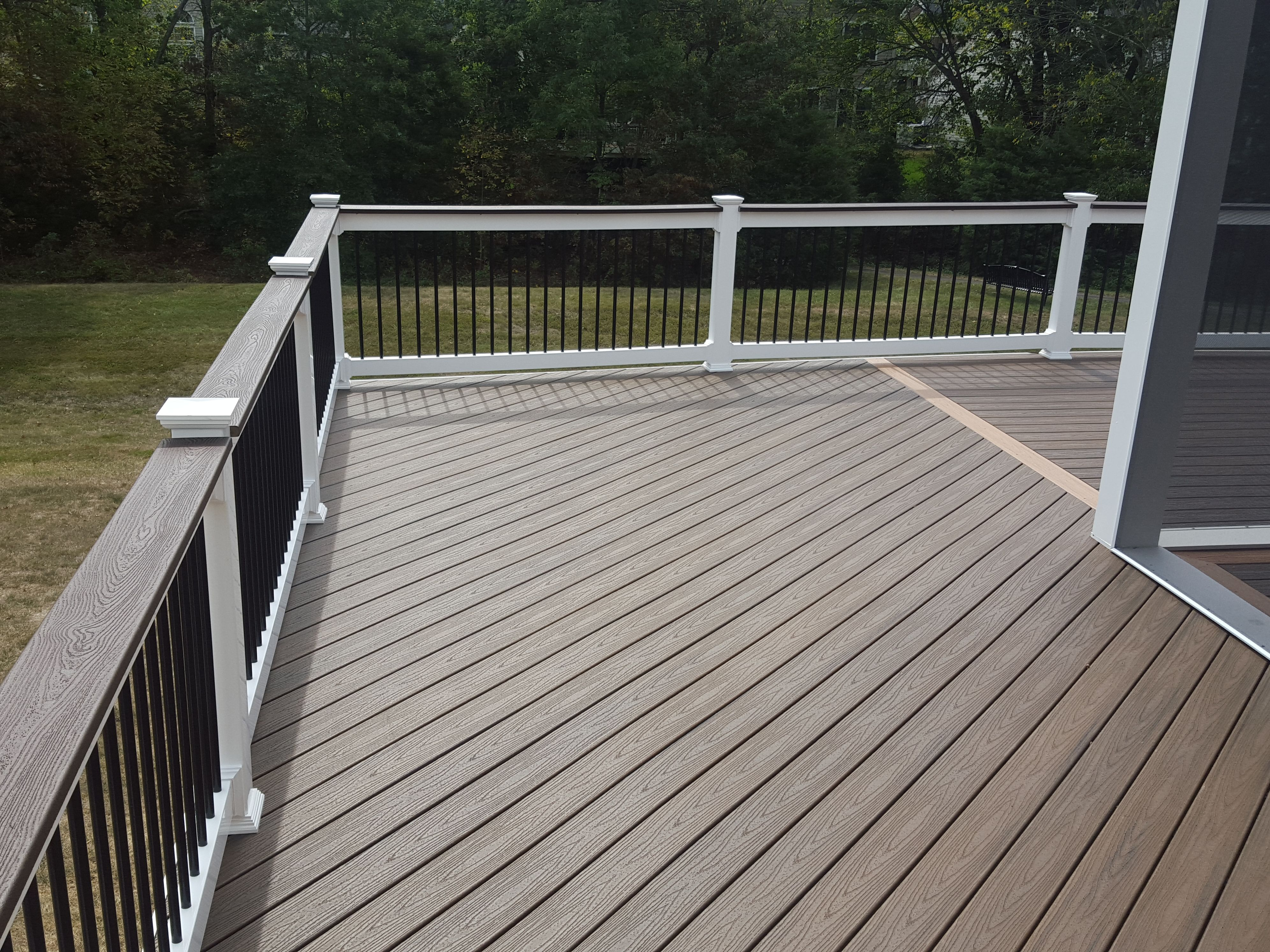This Deck Has Trex Decking Trex Handrails Vinyl Railings And Black Aluminum Balusters In Chantilly I Like Color Patio Builders Backyard Plan Vinyl Railing