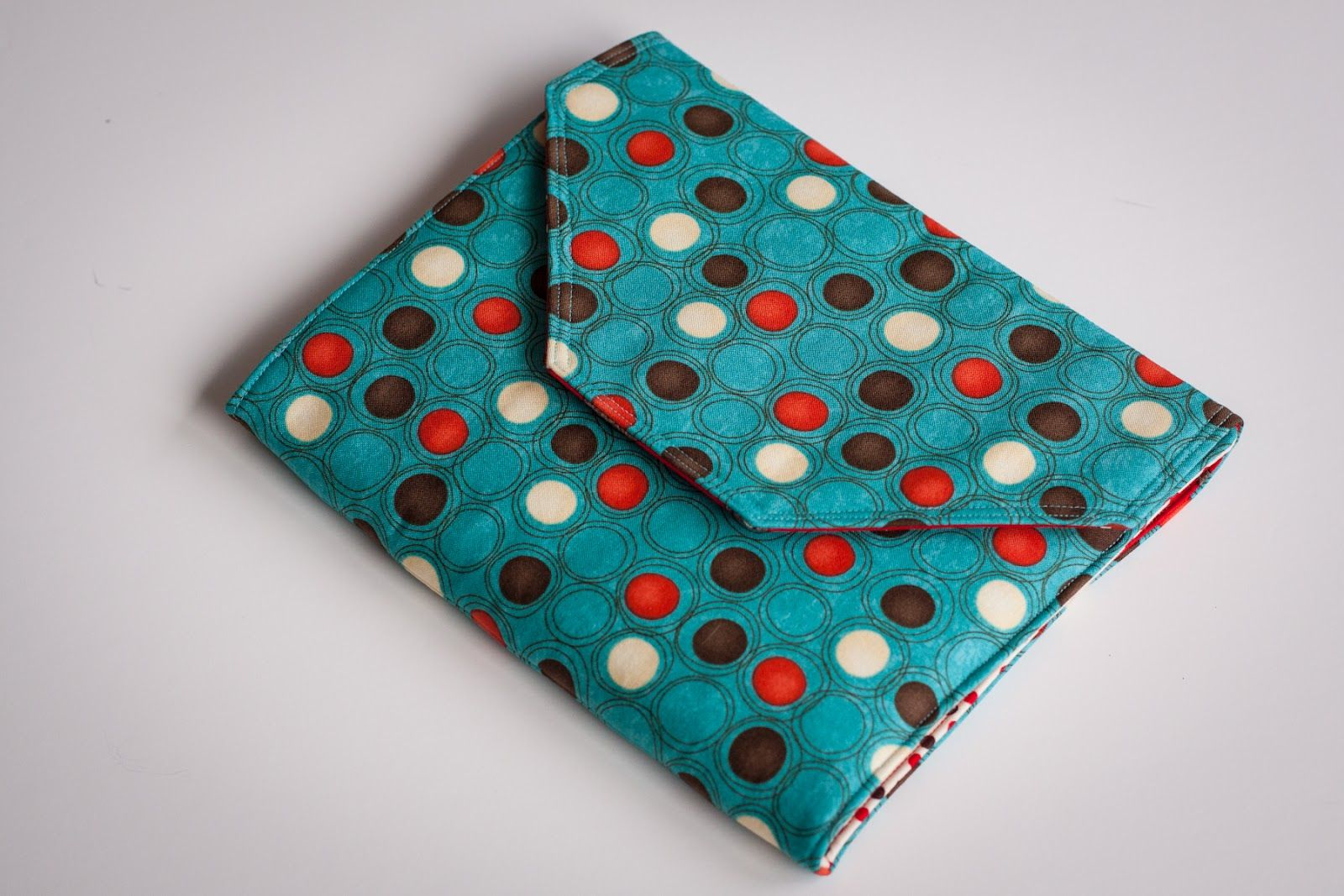 I spent today shopping for fabric and making my first Pencil/Crayon Wallet using a pattern by basketsofpatterns.etsy.com  . Emil...