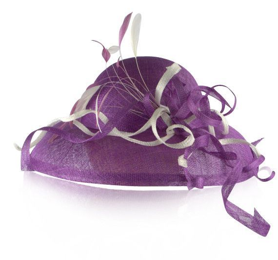 - Hue: Purple and white - Textile: Sinamay - Size: RTW 22 inches - Sinamay picture hat adorned with sinamay curls and feather spray,