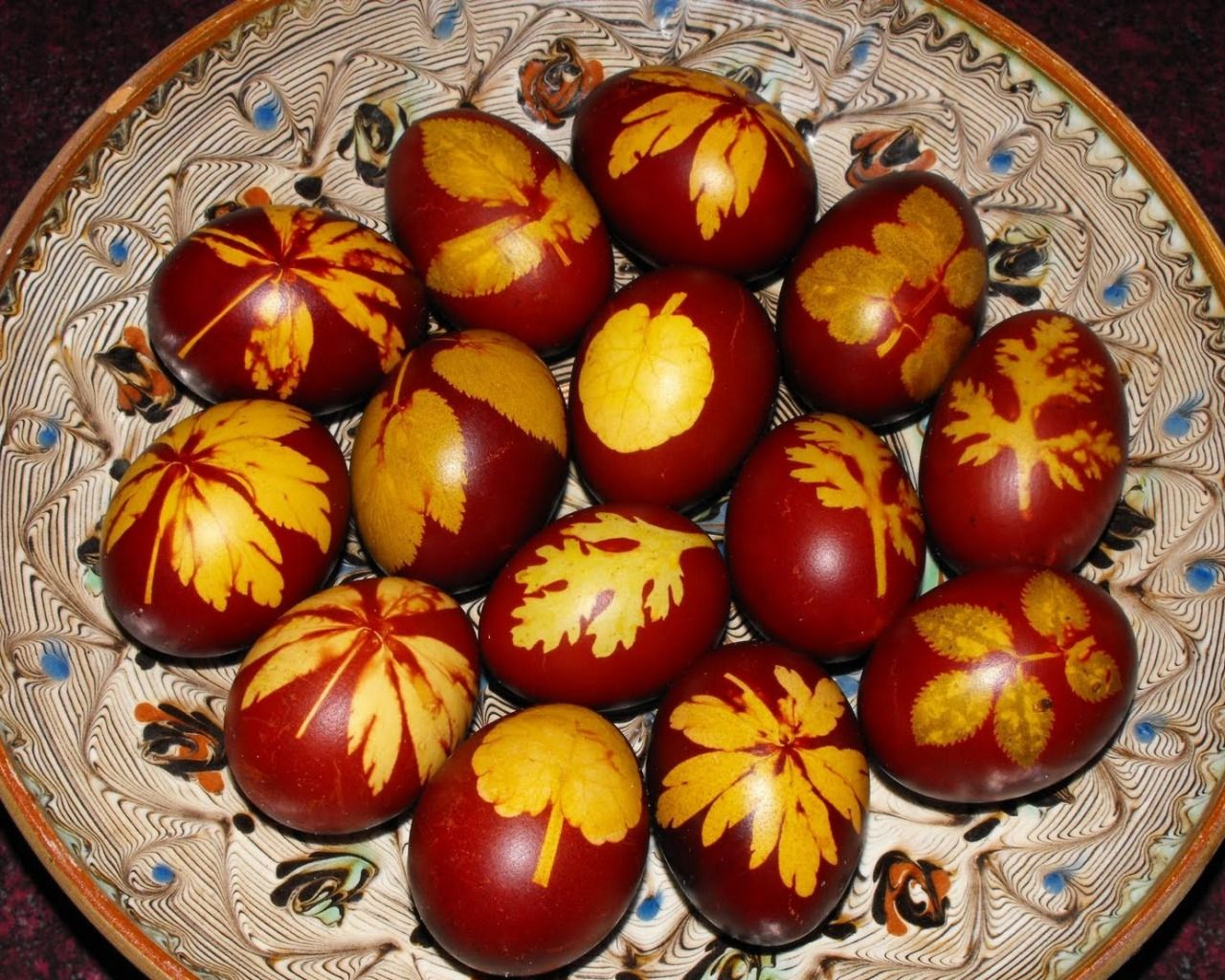 Easter eggs colored with onion shell an leaves in a traditional easter eggs colored with onion shell an leaves in a traditional romanian plate negle Choice Image
