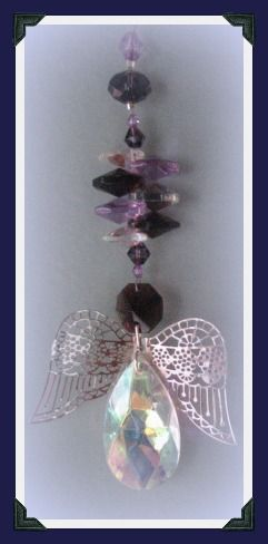 If you were a tear drop in my eye,  I wouldn't cry in case I lost you ~Unknown    I have combined shades of lilac and amethyst to symbolize your grief in this rear vision hanger and added a beautifully faceted 4x2cm crystal tear shaped body.    Length: 15.5cm