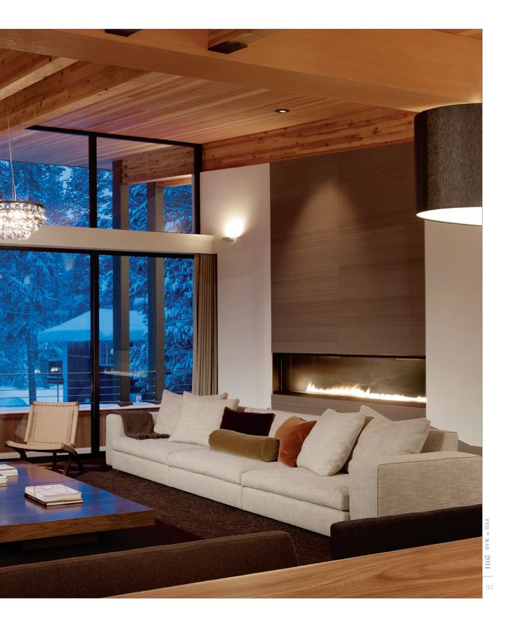 :: FIREPLACES :: simple yet elegant fireplace with flush stone surround #fireplaces...so warm and inviting.