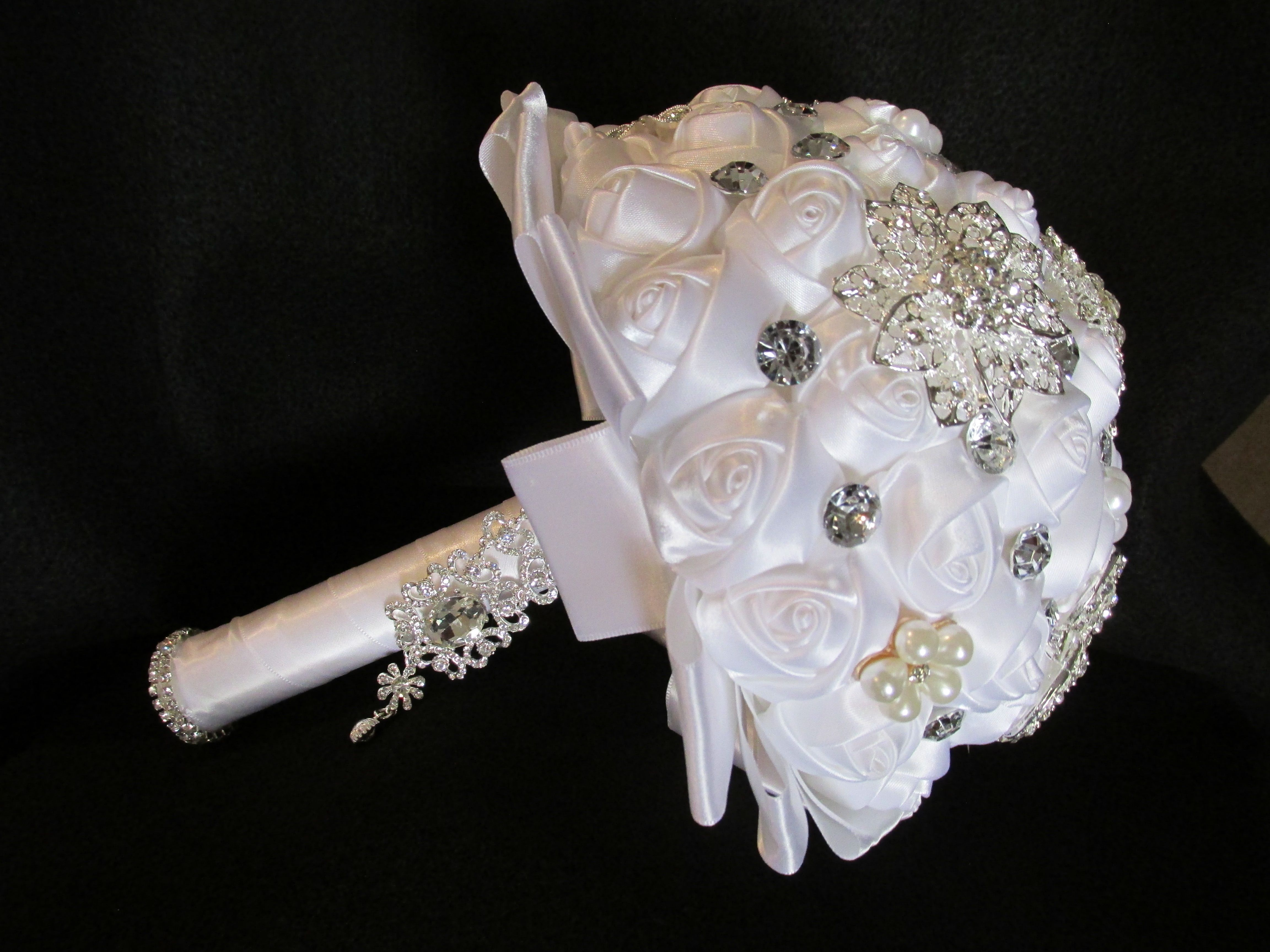 This beautiful brooch bouquet will compliment any color dress the bride may choose. Also great for bridesmaids.