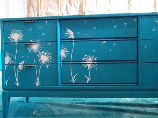 Midcentury dresser refinished in teal with white dandelions. Facebook.com/mvredesign