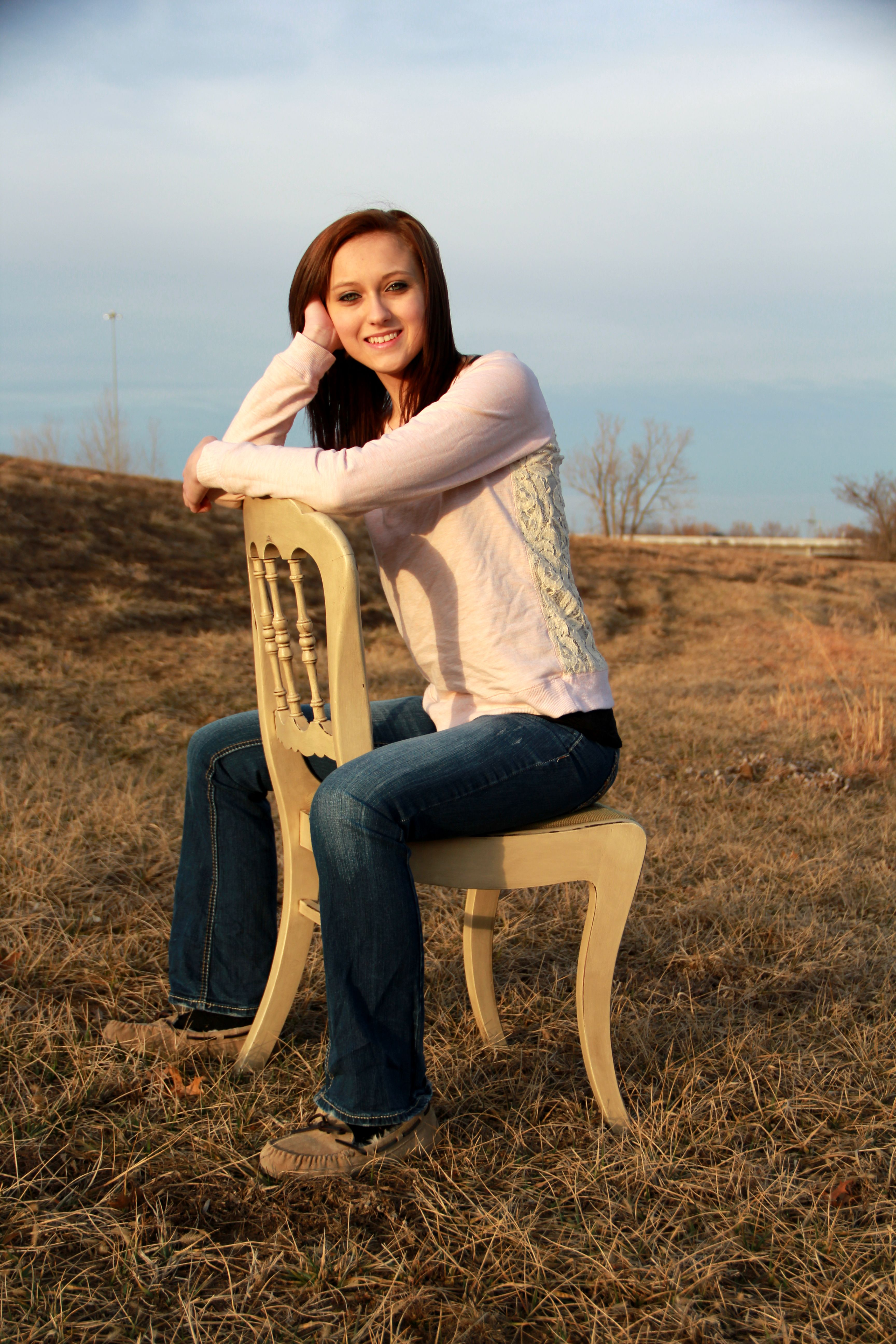 Female Senior picture using a chair as prop. Photograph by Gloria Webster