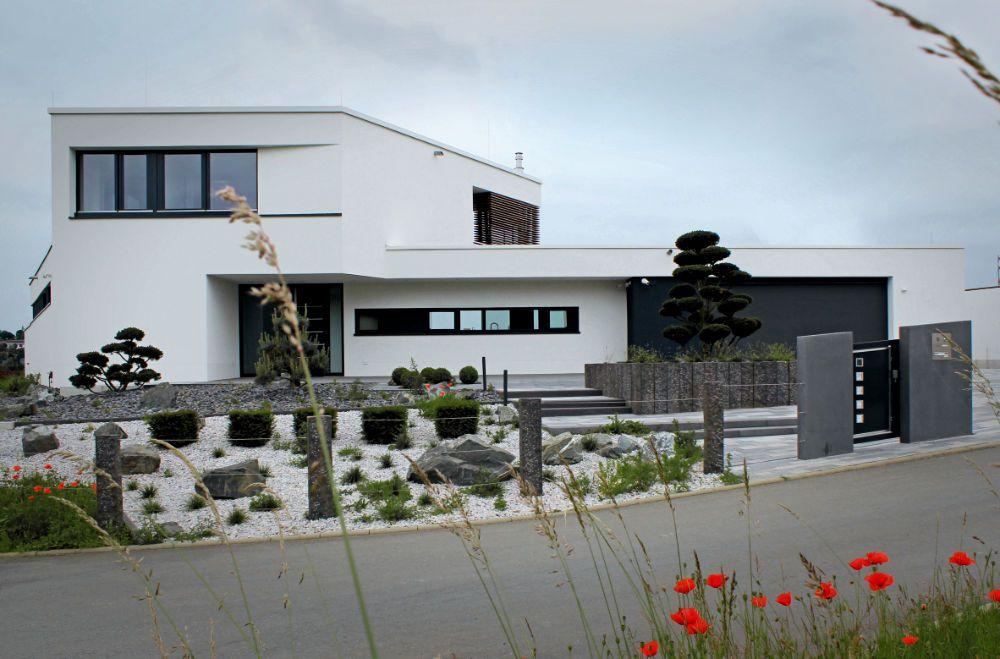 Modernes Flachdachhaus mit Dachterrasse Flachdachhaus
