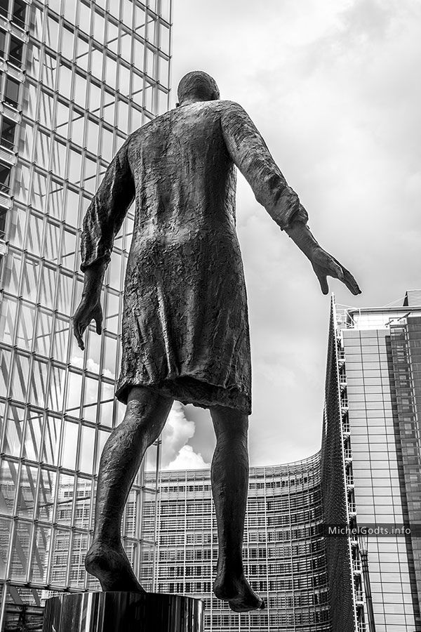 Stepping forward eu black and white statue photography monumental bronze statue in the european quarter of brussels see website for details