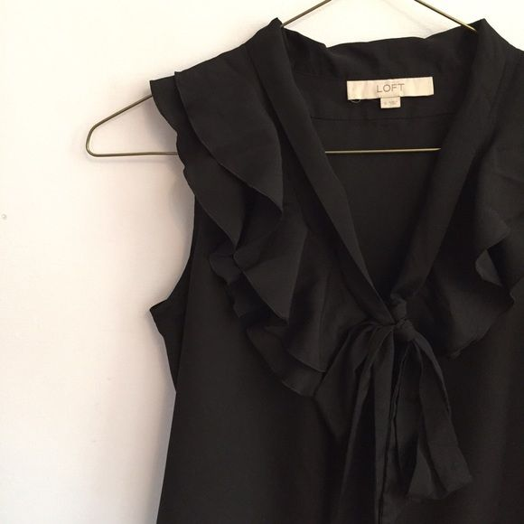 Black ruffle blouse Black blouse with ruffles on the front. Also has a bow on the front. ** send offers ** LOFT Tops Blouses