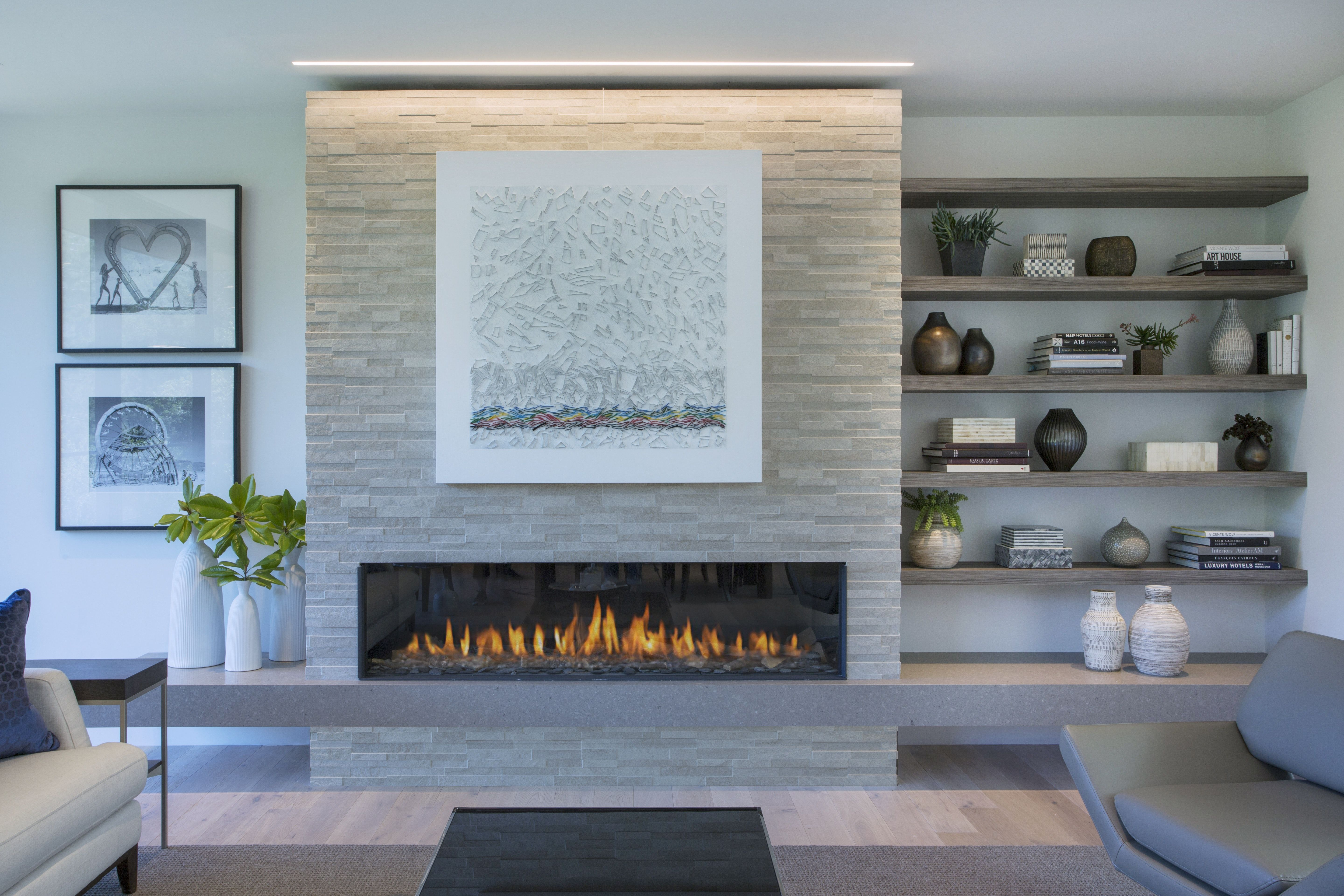 Modern Fireplace With Textured Tile Light Strip Above And Accessorized Shelves Modern Fireplace Decor Modern Fireplace Contemporary Fireplace Designs