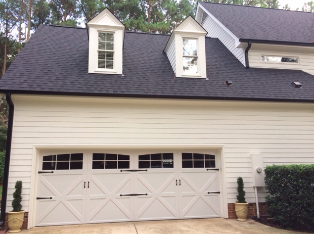 Carriage House Double Garage Door With Wrought Iron Hardware House Painted In Benjamin Moore White Dove Garage Doors Double Garage Door Wrought Iron Hardware