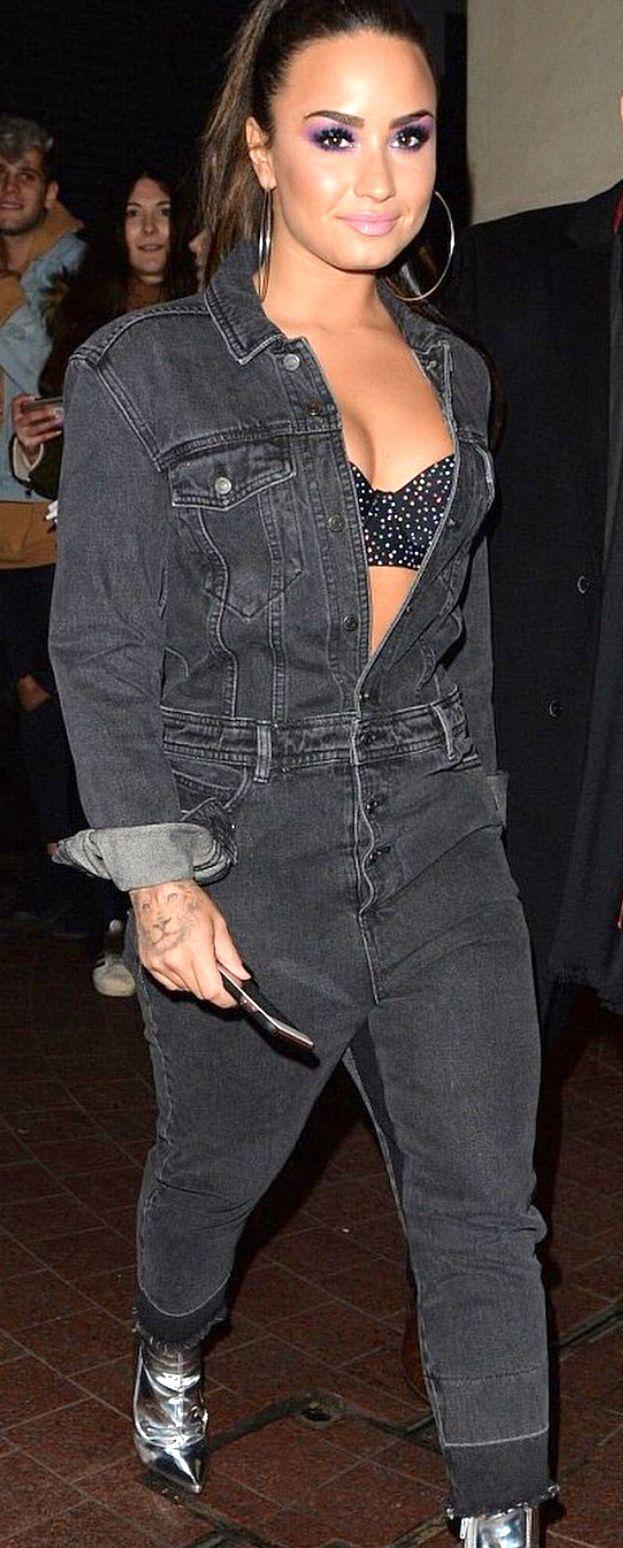 b47d2583781a Pinterest  DEBORAHPRAHA ♥ Demi Lovato wearing open black denim jumpsuit and  silver boots  demilovato