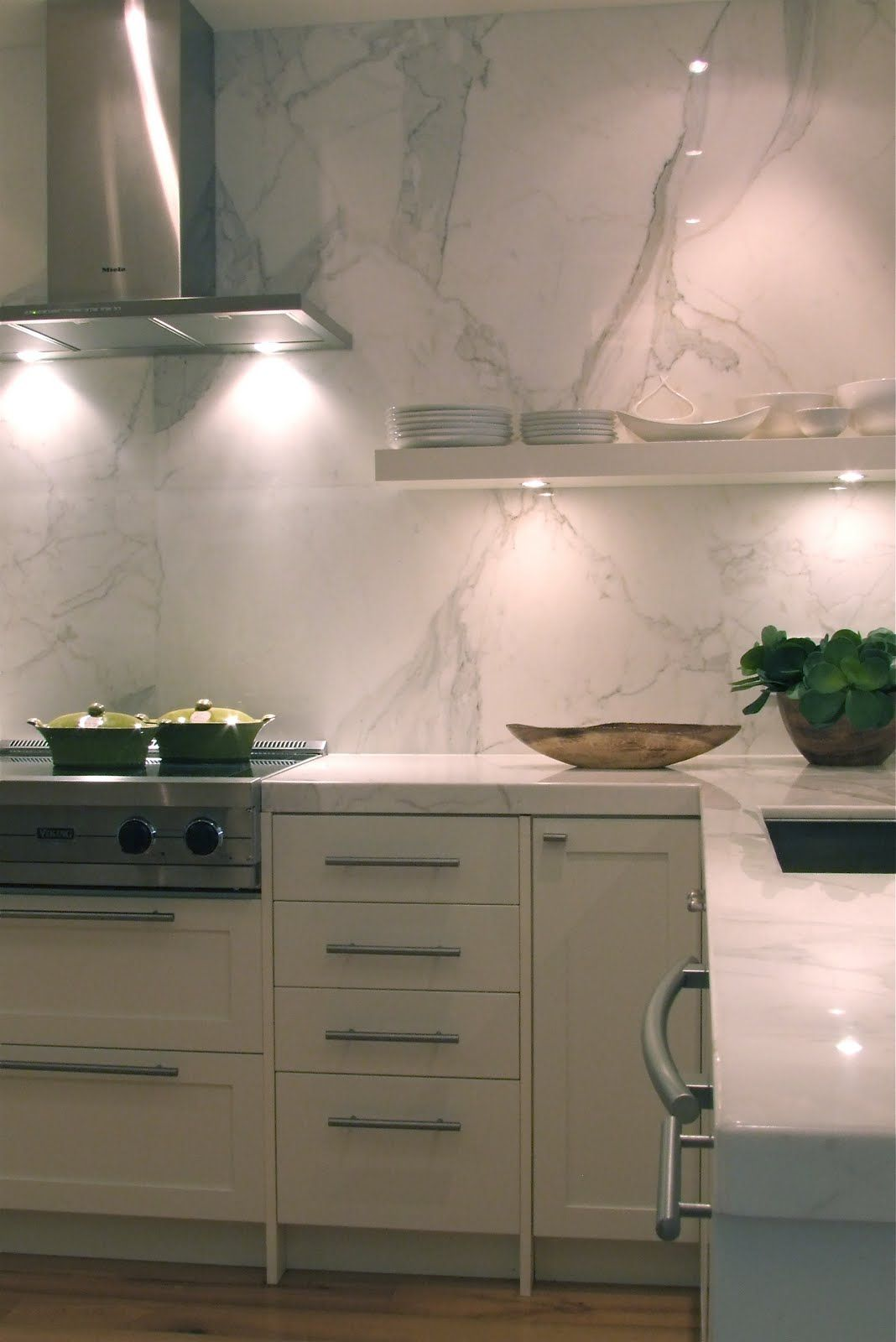 ikea cabinet lighting. ikea kitchen with marble. wish i had this kind of money to through into my cabinet lighting \