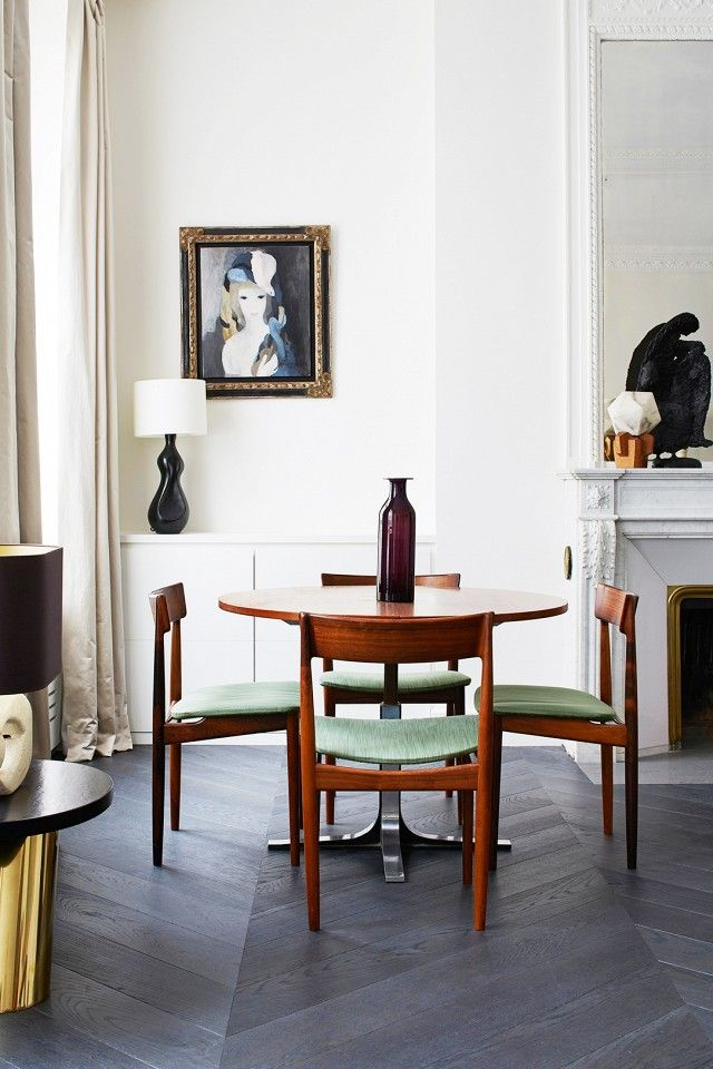 Superbe French Inspired Dining Space With Gray Herringbone Floors, Mid Century  Modern Chairs, And Vintage Art