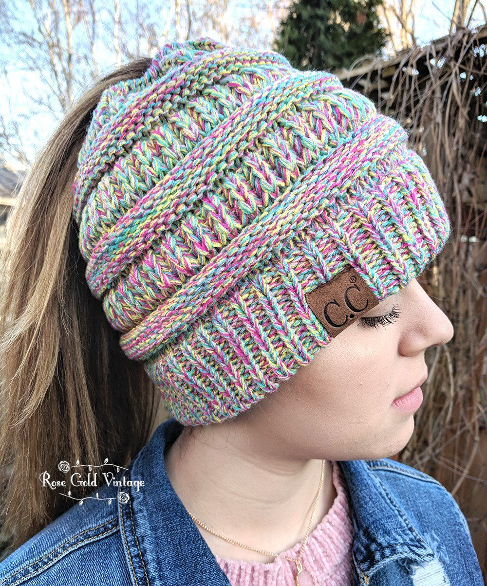88ca7ab7a9c443 The popular CC Beanie is now in a Messy Bun / Ponytail style! These feature  an elastic opening at the top of the beanie, to pull your hair through.