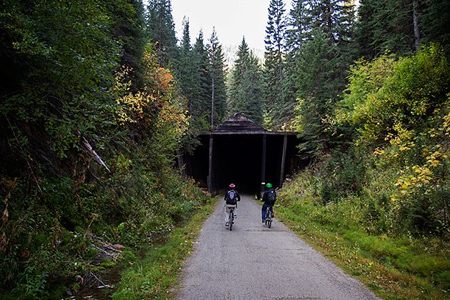 """Billed as one of America's most unforgettable bike rides, the 15-mile Hiawatha Trail follows the path of a former train route through pitch-black tunnels and across bridges which overlook vast valleys of pine. On the final weekend of the season, we rented bikes and completed the trail — """"unforgettable"""" doesn't even begin to describe it."""