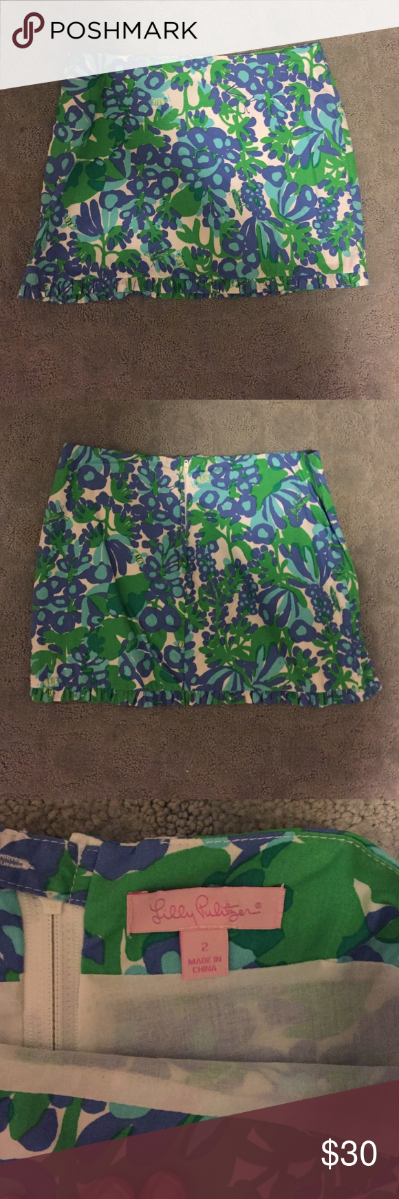 Lilly Pulitzer Size 2 Mini Skirt Lilly Pulitzer mini skirt, ruffle detail at the hem. Hits about mid thigh and low waisted. Worn twice. Lilly Pulitzer Skirts Mini