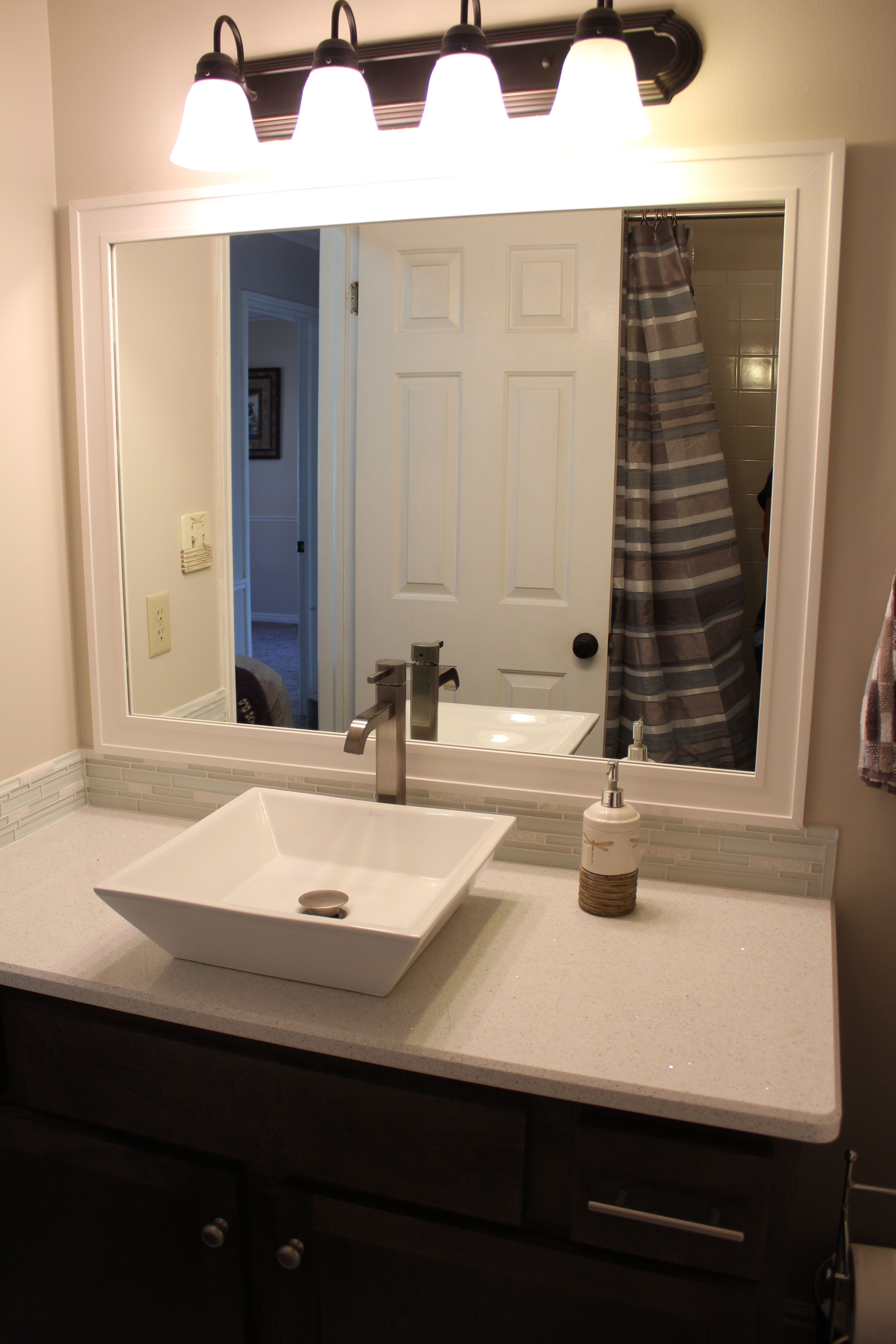 This White Craftsman Style Frame Is The Most Versatile Bathroom Mirror