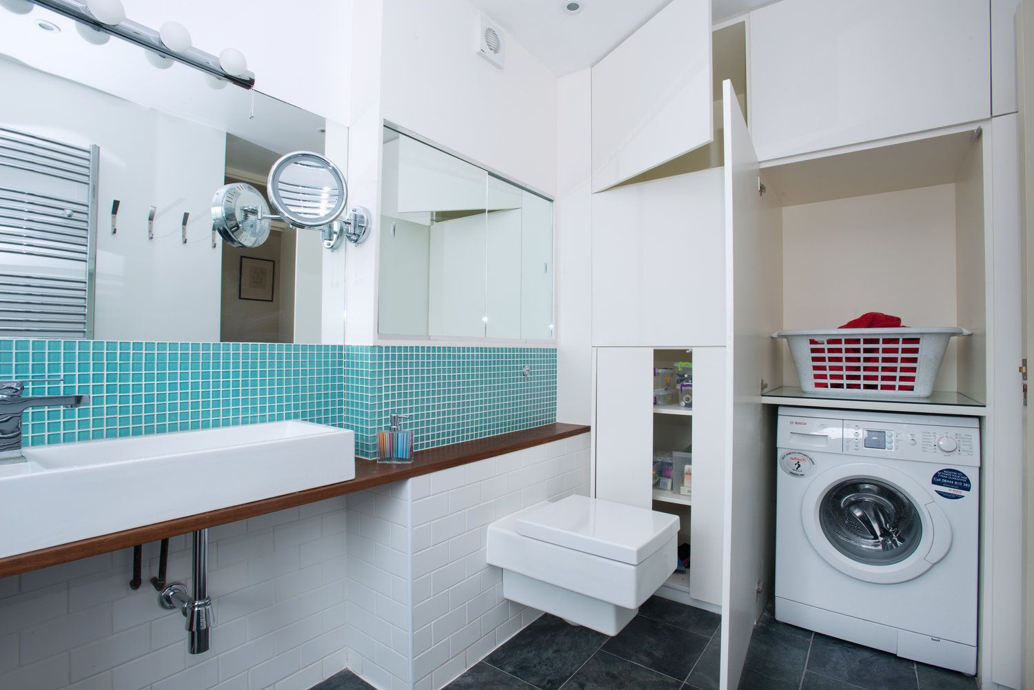 Bespoke laundry storage for this Barbican bathroom | Interiors ...