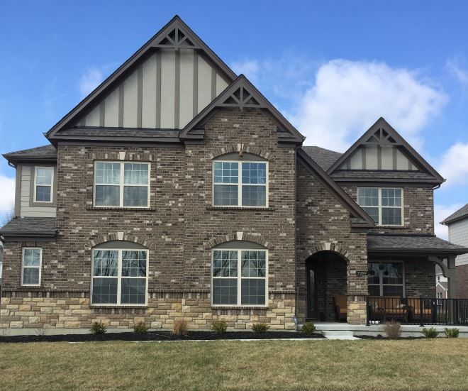 Essex tudor brick with algonquin stone terratone trim for Tudor siding
