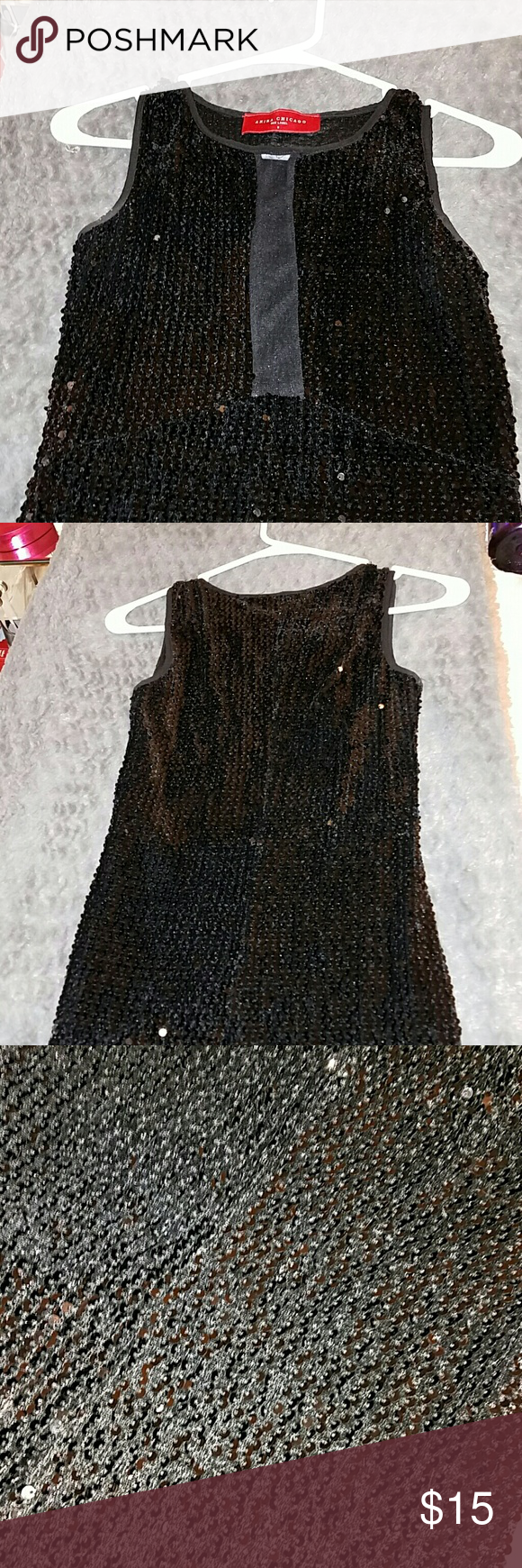 Black sequin dress. All sequin dress. Front strip in front is a see through material. Mini dress. Perfect for that sexy little black dress! AKIRA Dresses Mini