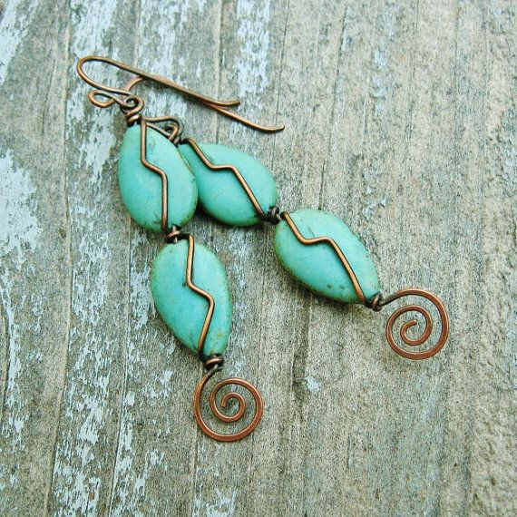 These wire wrapped stone dangle earrings are made up of aqua ...
