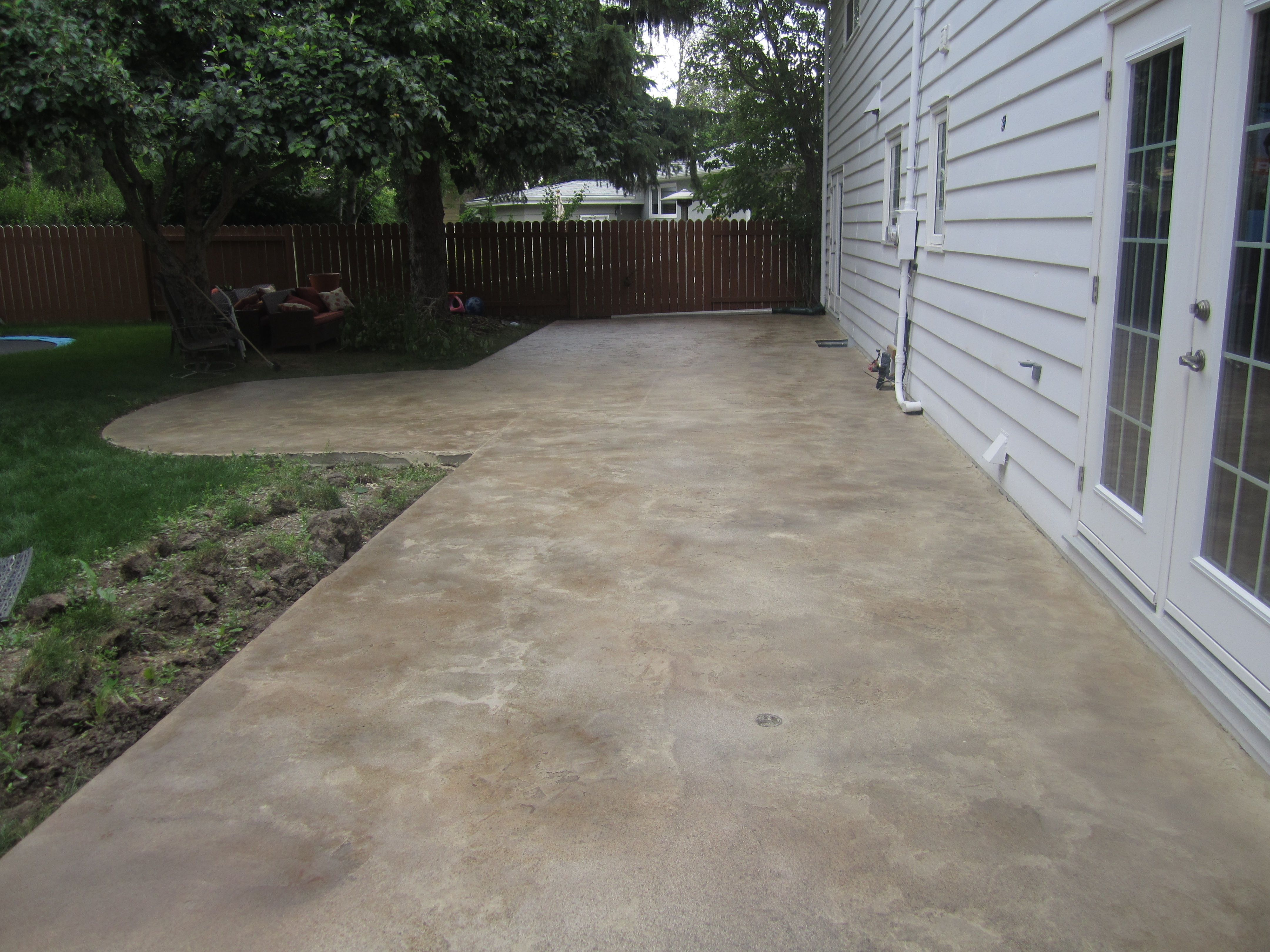 Thin Trowel Down Overlay To Upgrade Basic Concrete Patio.