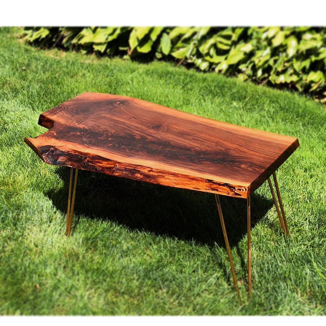 Walnut live edge table with copper hairpin legs . . .