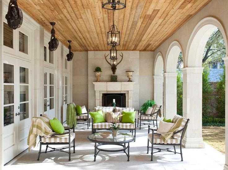 Transitional covered patio features a stained plank ceiling dotted
