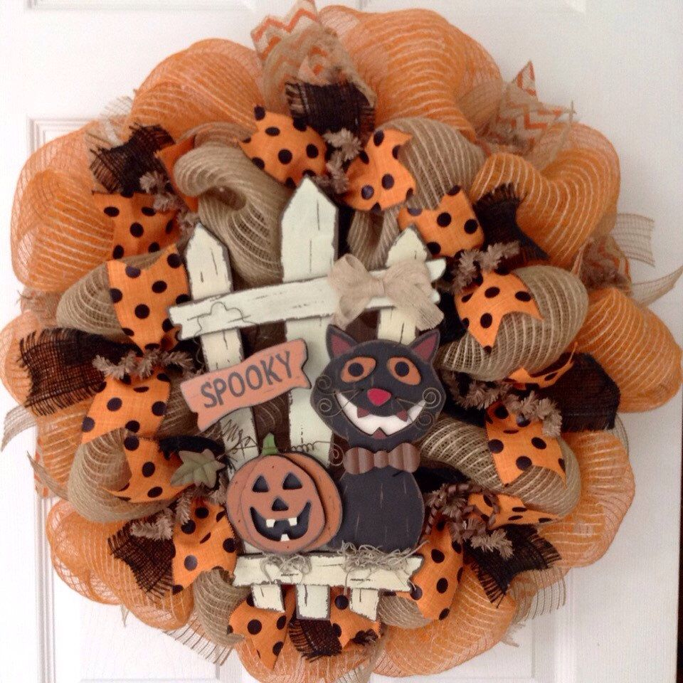 A personal favorite from my Etsy shop https://www.etsy.com/listing/248741359/grinning-halloween-cat-handmade-deco