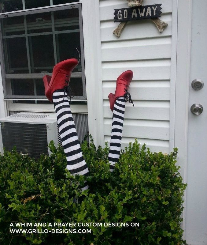 A blogger glues up a newspaper leg for this freaky Halloween porch - halloween outside decoration ideas