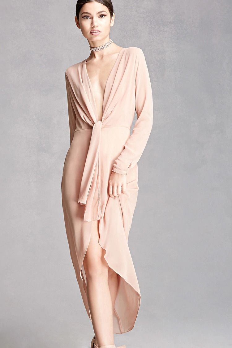 A sheer woven dress featuring a plunging neckline with a selftie