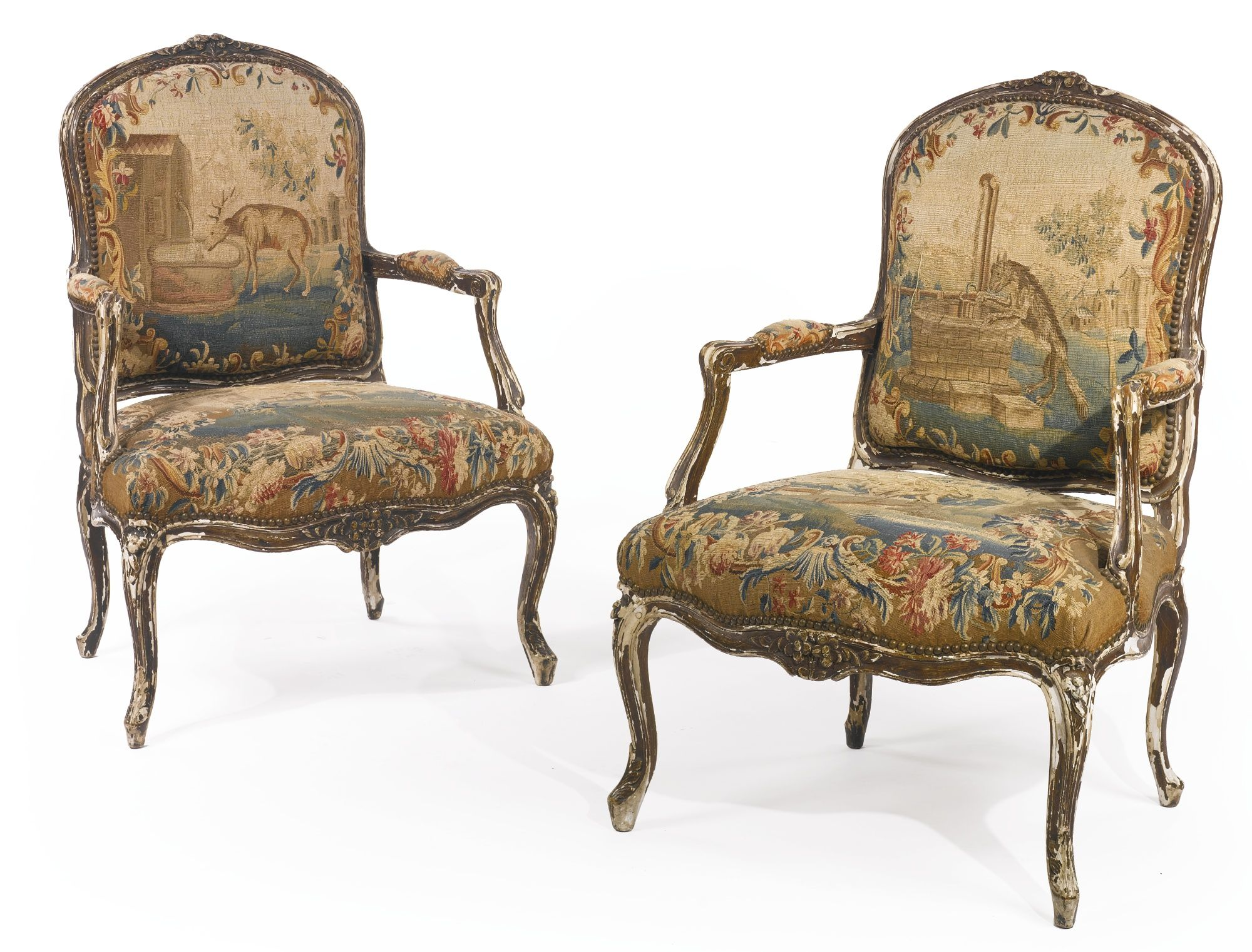 A pair of Louis XV carved and faux wood painted fauteuils Mid 18th