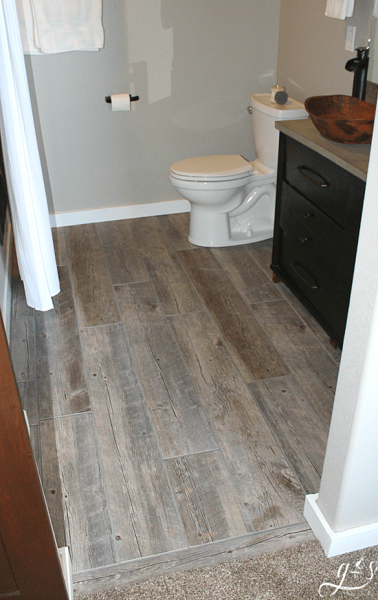 Diy How To Lay Floor Tile Planks Our Master Suite Bathroom Floor Is Rustic And Fun With The Light T Master Suite Bathroom Wood Tile Bathroom Wood Tile Floors