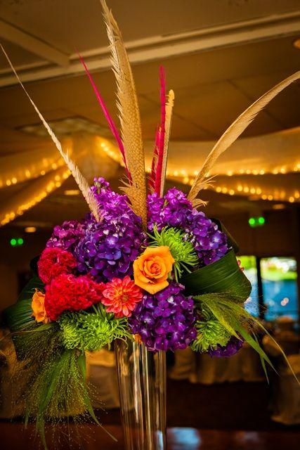 Orange and purple wedding centerpieces reception