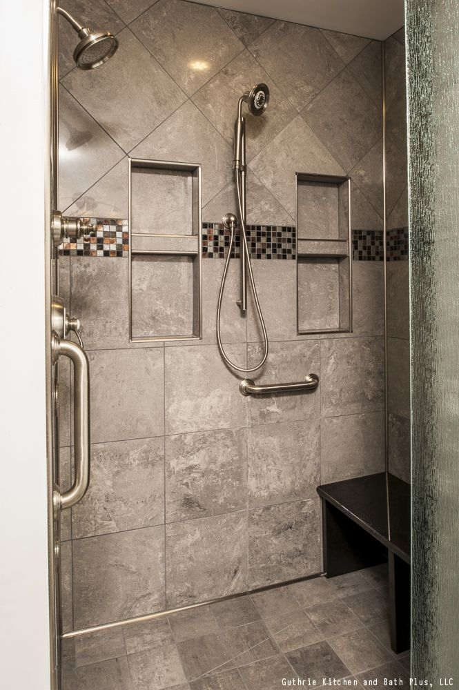 This contemporary style shower has two shower heads and a frosted ...