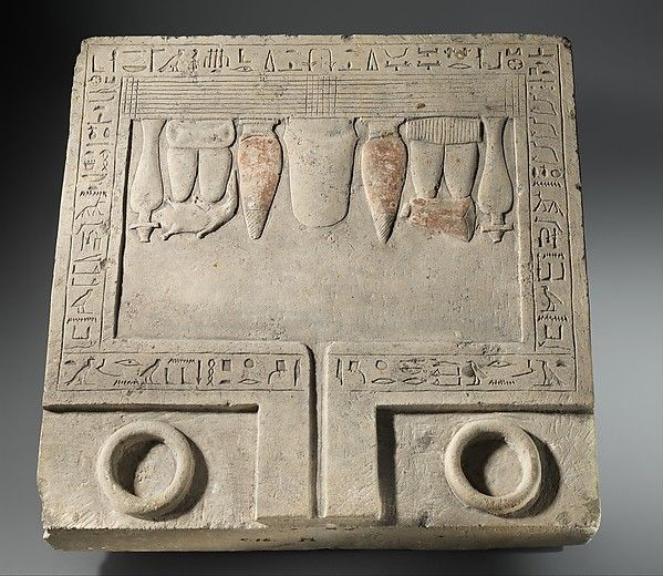 Offering Table of the Overseers of Scribes Senbebu and Dedusobek Period: Middle Kingdom Dynasty: Dynasty 12 Date: ca. 1981-1802 B.C. - Limestone, paint