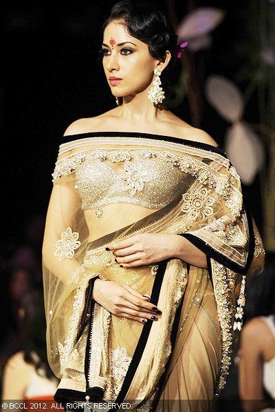 A model displays a creation by designer Tarun Tahiliani on Day 1 of India Bridal Fashion week, held in Mumbai.