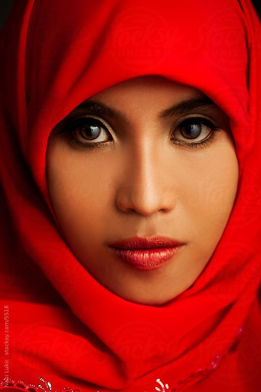Portrait of a beautiful muslim woman in traditional red hijab by Nabi Tang