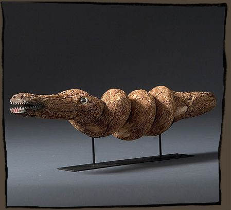 ALLIGATOR  JESSE AARON  Twisted root branch with applied glass eyes and cut tin mouth.  30''l x 6'' w x 9''h