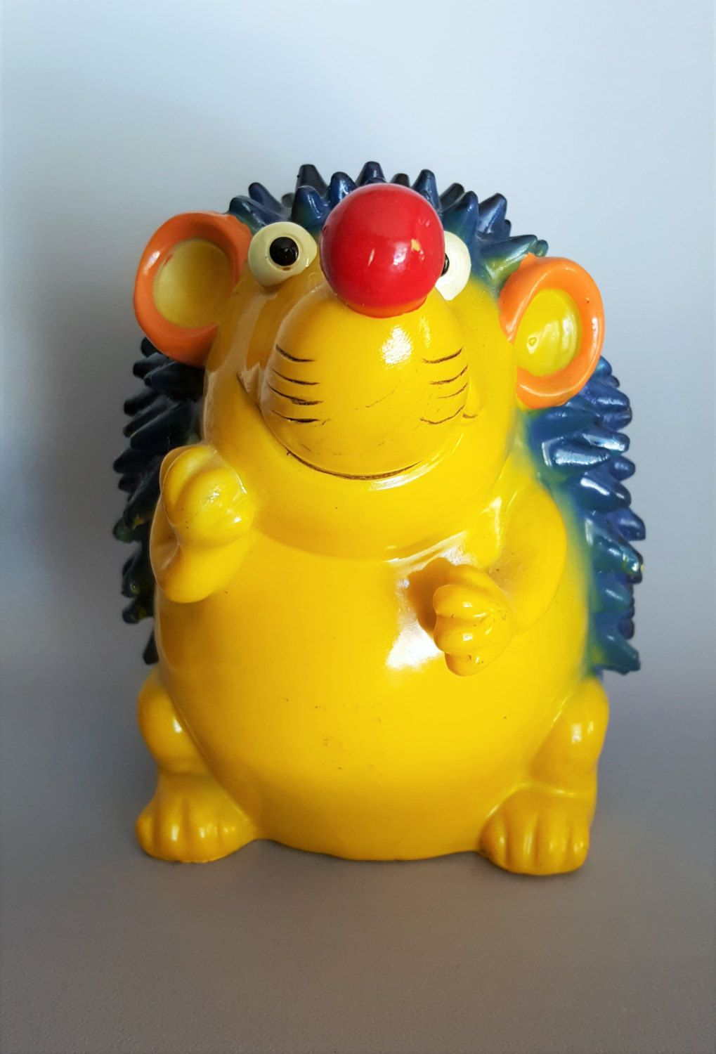 Hedgehog coin bank vintage 1970s composition material blue and yellow adorable by CircularVintage on Etsy