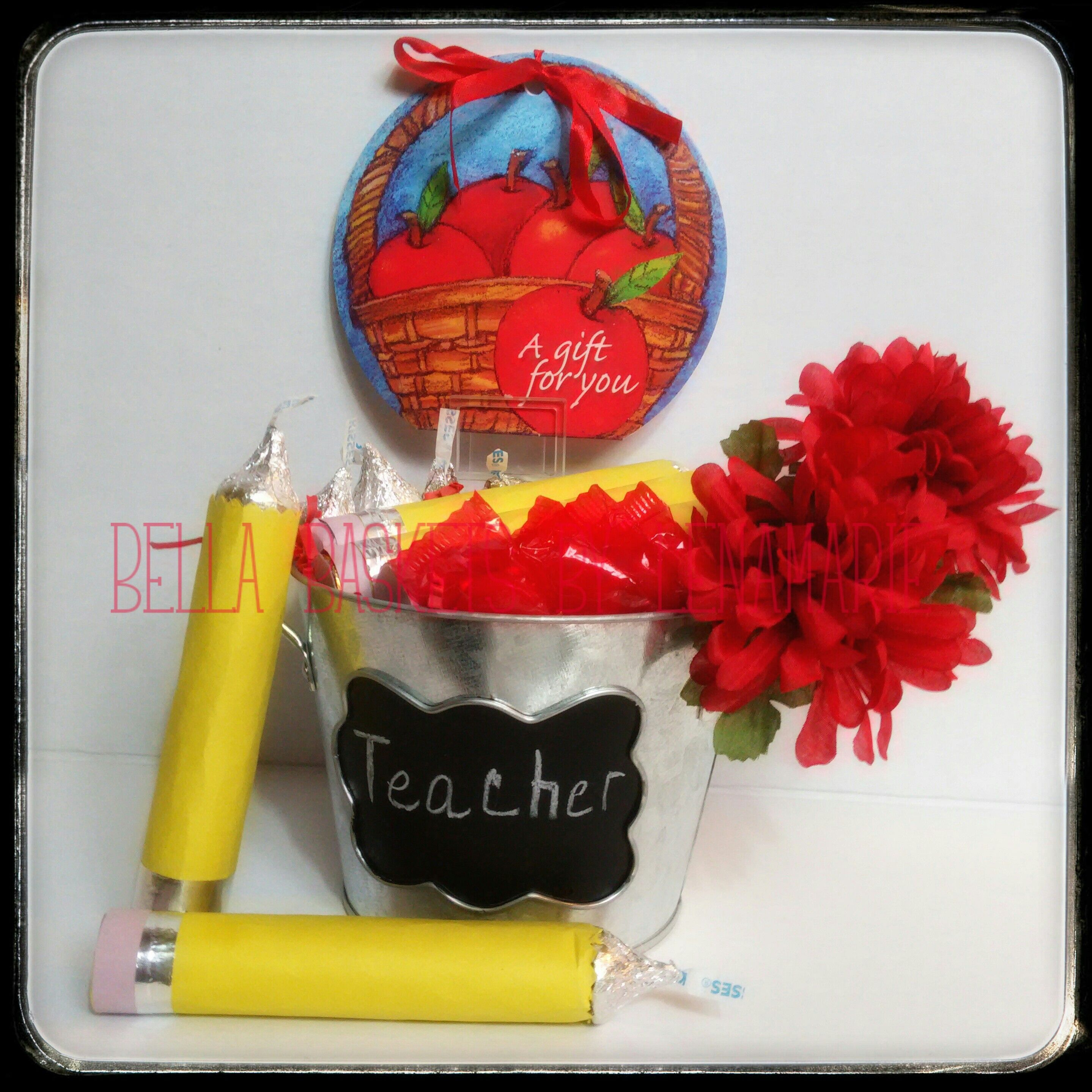 No #1 Teacher Teacher Appreciation Week May 2nd - 6th, 2016 Includes: 3 Rolo Chocolate Pencils, Cinnamon Discs and Hershey Kisses all tucked inside a Metal Chalkboard Pail. Perfect pencil/pen bucket once the candy is gone.  $24.98 Bella Baskets by Lenamarie  bellabaskets@mail.com