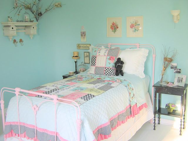 Love the black table and vintage prints against that aqua wall!  Tracy Porter bedding