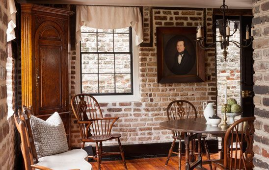 Exposed Brick Wall In Breakfast Room With Antique Wood