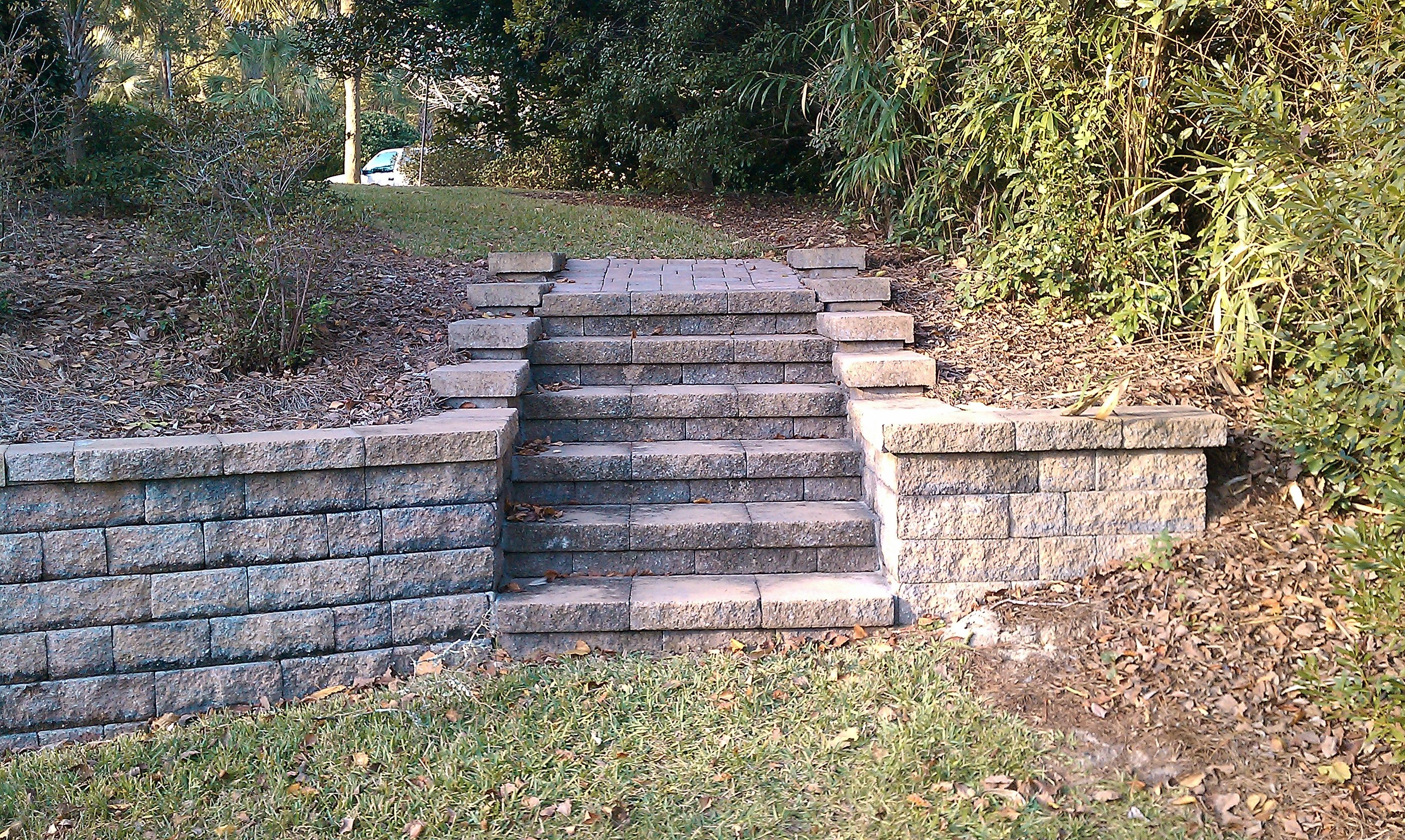 Belgard Celtik Wall Block And Cap System Was Used To Create A Two Tiered Yard Steps Flatter Backyard