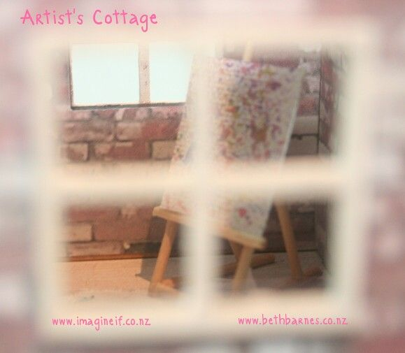 Peeping through the window of the mini Artist's Cottage by @Beth Barnes