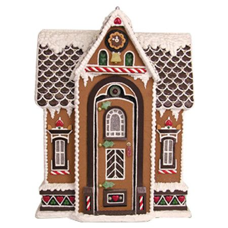Faux gingerbread house decor.  Product: Gingerbread house decorConstruction Material: ResinColor: Mul...